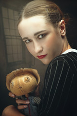 Master of Puppet. Spooky female portrait with crazy doll