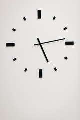 clock in white wall