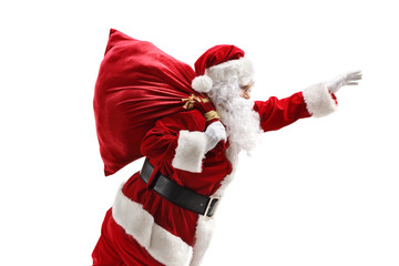 Santa Claus carrying a sac and gesturing with hand