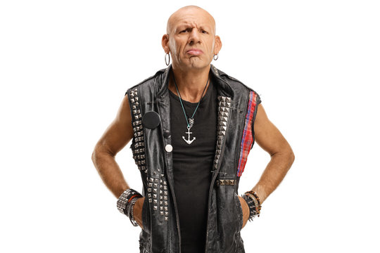 Portrait of a serious middle-aged bald punk in a leather vest