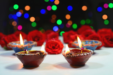 Oil lamps and flowers decorated for Diwali festival