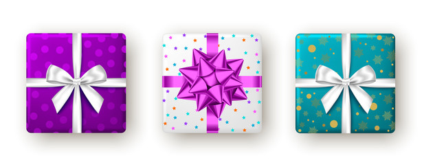 Fotomurales - Gift box with purple, white ribbon and bow, top view.