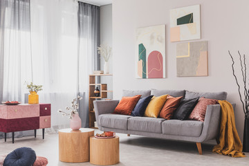 Coffee table in front of grey couch in scandinavian living room