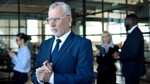 Pensive mature businessman thinking of problem, responsibility for decision