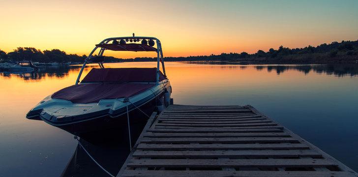 Boat near a pier at sunrise