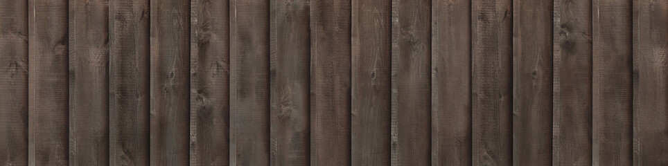 Brown wood fence (vertical boards)