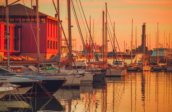 Panoramic view of old port of Genoa at sunset, Liguria, Italy