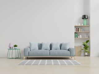 Modern living room interior with sofa and green plants,lamp,table on white wall background.
