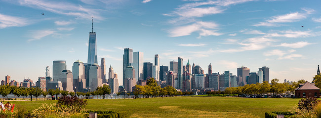Wall Mural - New York Skyline showing several prominent buildings and hotels under a blue sky.