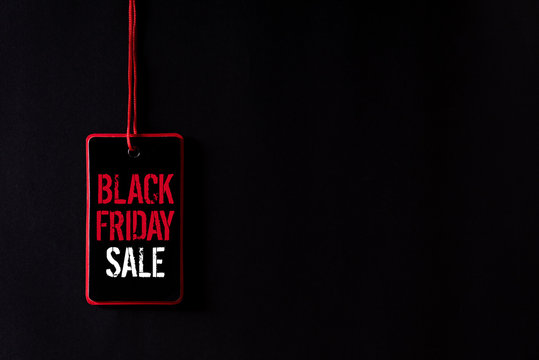 Black Friday Sale text on a red and black tag. Shopping concept.