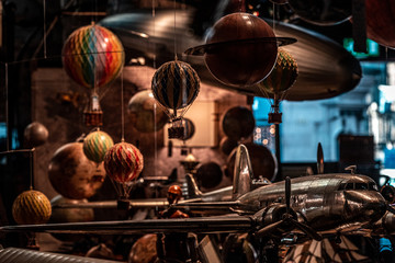 Lots of old toys together with small hot air balloons hanging, planes and airships softly illuminated. Concept of nostalgic memories.
