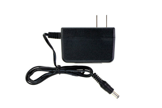 Image of Black Electric power adapter isolated on white background. Computer hardware.