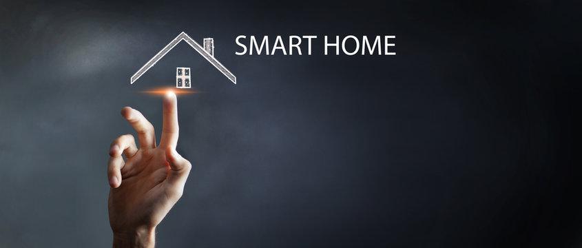 businessman presses smart home icon