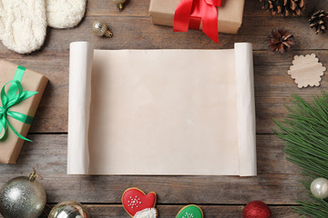 Fotobehang - Flat lay composition with empty card and Christmas decorations on wooden table, space for text. Writing letter to Santa Claus