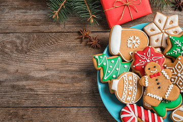 Fotobehang - Flat lay composition with tasty homemade Christmas cookies on wooden table. Space for text