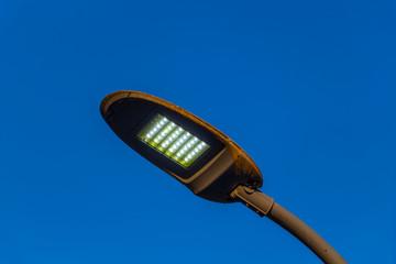 Modern street lamp against the blue sky. Fotomurales