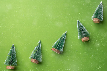 Merry Christmas and Happy New Year concept. green christman tree on  green lime background with...