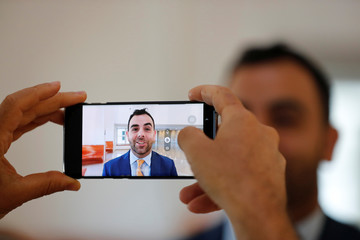 Omar Shakir, Human Rights WatchÕs Israel and Palestine Director, is seen on a mobile phone screen as he is interviewed by a member of the media before his hearing at Israel's Supreme Court in Jerusalem