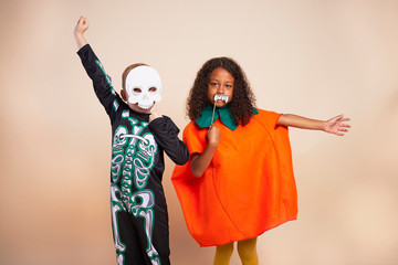 Cheerful children with Halloween costume