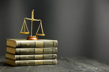 Law concept - Open law book with a wooden judges gavel on table in a courtroom or law enforcement office Wall mural
