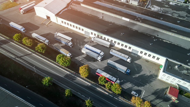 trucks waiting to be loaded in the logistics center top view