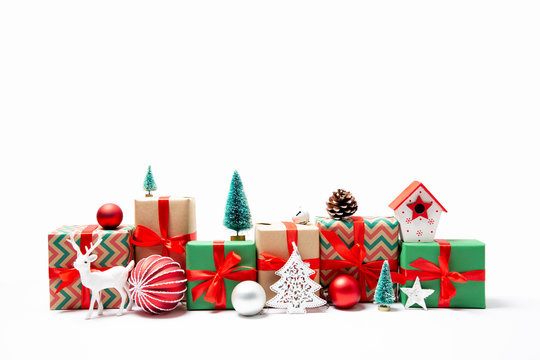 Row of Christmas presents and ornaments isolated on white
