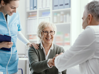 Doctor giving an handshake to a senior patient