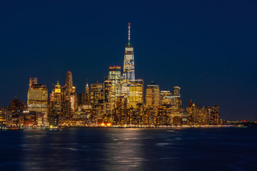 Fotomurales - Lower Manhattan which is a apart of New york cityscape river side which can see One world trade center at twilight time, USA, Taking from New Jersey