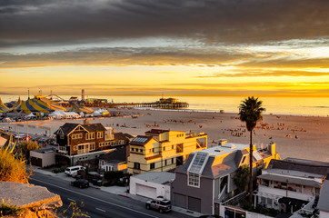 Beautiful sunset on Santa Monica beach, with view of beach homes and famous Santa Monica pier.