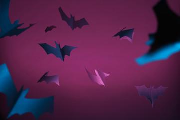 Halloween image of blue bats on purple background.