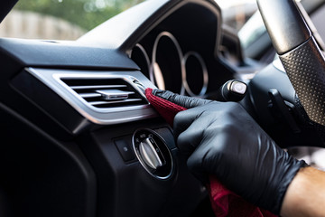 Polishing the car, cleaning the interior of the car with a microfiber cloth