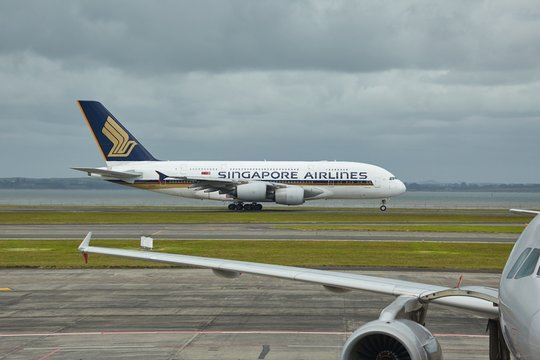 AUCKLAND AIRPORT, NEW ZEALAND - MARCH 7, 2016: Singapore Airlines Airbus A380 on the runway at Auckland Airport. The Airbus A380 is the largest passenger aircraft model.