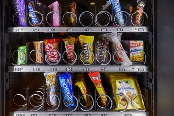 VIENNA, AUSTRIA - NOVEMBER 10, 2016: Vending machine selling snacks and drinks in a hostel in Vienna