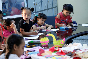 Libyan students practice drawing and calligraphy skills during the summer school programme at a local school in Tripoli