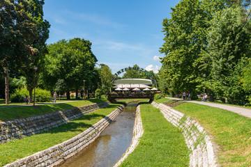 Loznica, Serbia - July 11, 2019: The river Štira in the center of Loznica. Intermezzo restaurant in the center of Loznica in Serbia.