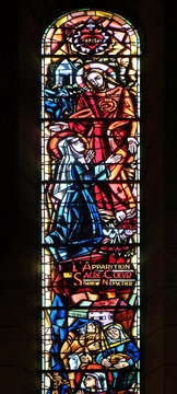 Scenes from the life of Saint Margaret Mary Alacoque: The appearance of the Sacred Heart in tree nuts, stained glass in Basilica of the Sacred Heart of Jesus in Paris