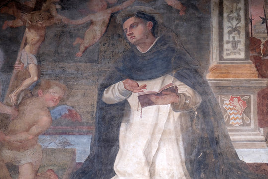 The lunette of one of the side doors depicting St. Thomas Aquinas, detail of the facade of the Church of Santa Maria Novella in Florence, Italy