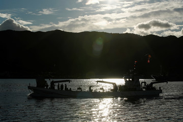 A fishing vessel returns with a catch at the Ofunato fish market in Ofunato
