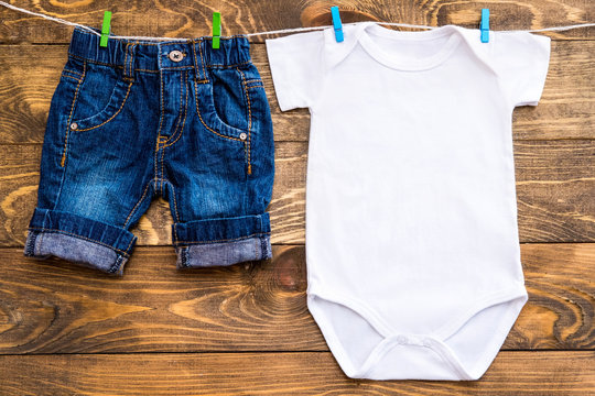 Mockup of white baby bodysuit shirt and jeans