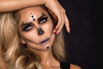 Sexy witch with Halloween skeleton make up - Image Wall mural