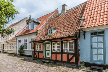 A romantic fairytale halftimbered house on a cobblestone street