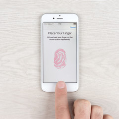 Touch ID application on an Apple iPhone display. Touch ID is a fingerprint recognition feature, designed and released by Apple Inc.