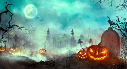 Halloween pumpkins on the graveyard