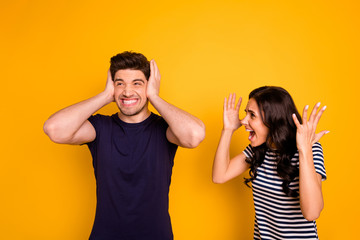 Portrait of nice attractive irritated annoyed sullen gloomy grumpy aggressive married spouses having anger pretense argument fail failure crisis isolated on bright vivid shine yellow background
