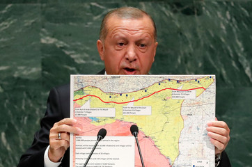 Turkey's President Recep Tayyip Erdogan holds up a map as he addresses the 74th session of the United Nations General Assembly at U.N. headquarters in New York City, New York, U.S.