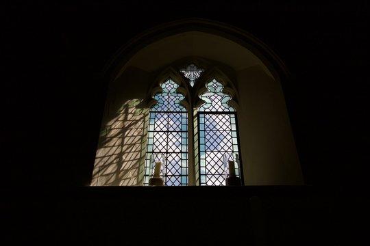 Light shining through Christian church glass window