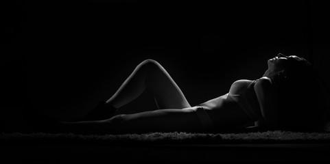 Female photo session. Sexy woman in a photo studio