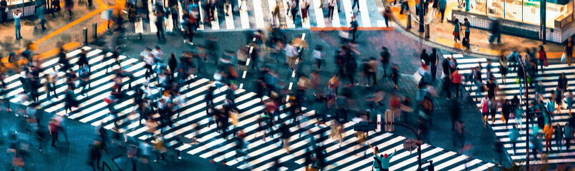 Pedestrians cross the Shibuya Scramble crosswalk in Tokyo, Japan, one of the busiest intersections in the world