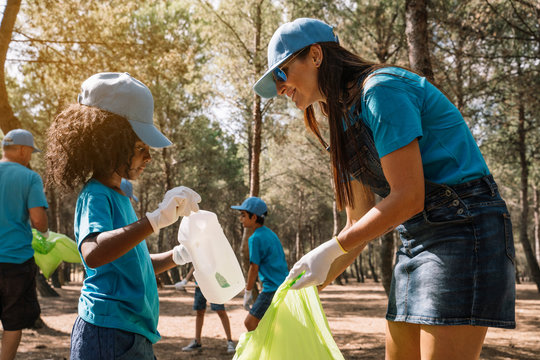 Group of volunteers collecting garbage in a park