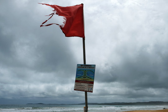 A ripped red flag warning rip currents waves as Tropical Storm Karen approaches in Luquillo